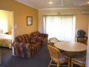 Ocean Spray Holiday Apartments - Lounge Room